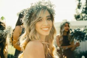 Smiling young woman at a wedding